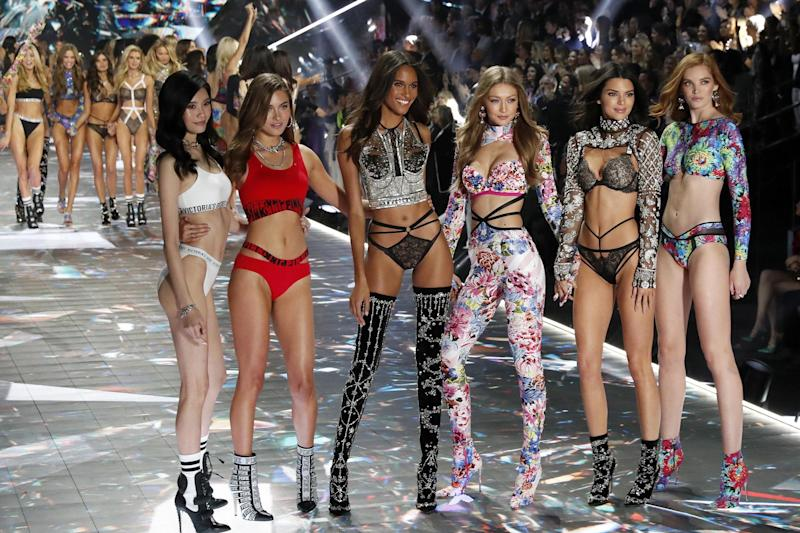 Victoria's Secret Angels pose on the runway during the lingerie giant's 2018 fashion show (EPA)