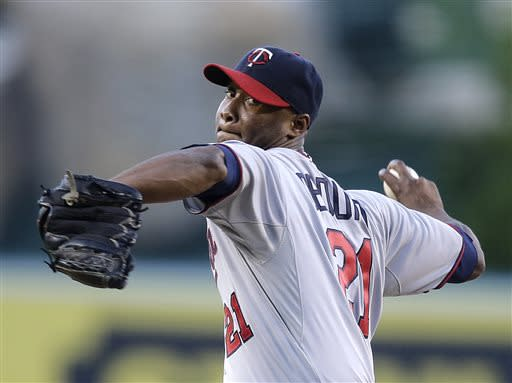 Minnesota Twins starting pitcher Samuel Deduno throws against the Los Angeles Angels during the first inning of a baseball game on Monday, July 22, 2013, in Anaheim, Calif. (AP Photo/Jae C. Hong)