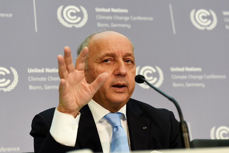 French Foreign Minister Laurent Fabius addresses the United Nations Framework Convention on Climate Change summit in Bonn, western Germany, on October 20, 2015 (AFP Photo/Patrik Stollarz)