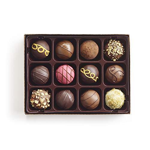 """<p><strong>Godiva</strong></p><p>amazon.com</p><p><strong>$28.76</strong></p><p><a href=""""https://www.amazon.com/dp/B00F3I4BVS?tag=syn-yahoo-20&ascsubtag=%5Bartid%7C10055.g.29654683%5Bsrc%7Cyahoo-us"""" target=""""_blank"""">Shop Now</a></p><p>Godiva is the definition of luxury, especially during the holiday season. This gift set comes with 12 different flavors, meaning whoever you gift it to can pick their favorite. (Or you can — we won't tell.)</p>"""