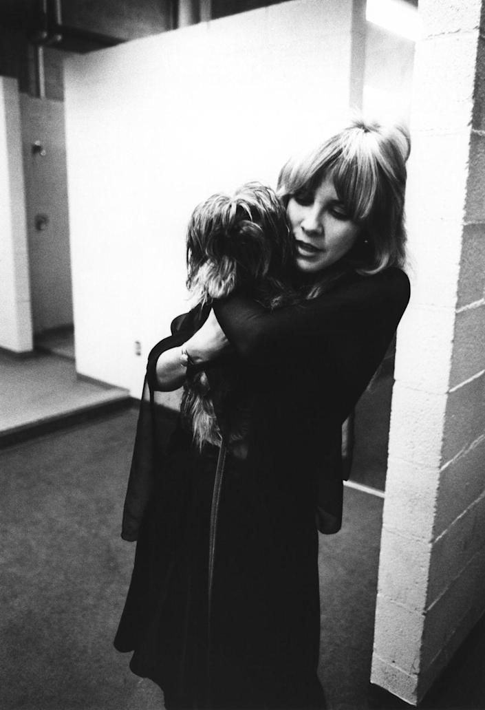 <p>Stevie Nicks of Fleetwood Mac poses backstage in New Haven holding her dog on October 1, 1975.</p>