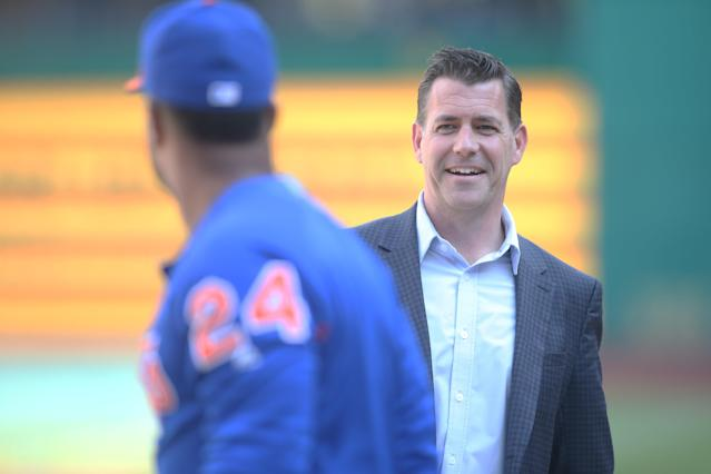 Aug 3, 2019; Pittsburgh, PA, USA; New York Mets general manager Brodie Van Wagenen (right) talks with second baseman Robinson Cano (left) during batting practice before a game against the Pittsburgh Pirates at PNC Park. Mandatory Credit: Charles LeClaire-USA TODAY Sports