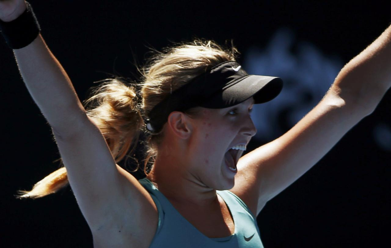 Eugenie Bouchard of Canada celebrates defeating Ana Ivanovic of Serbia in their women's quarter-final tennis match at the Australian Open 2014 tennis tournament in Melbourne January 21, 2014. REUTERS/Petar Kujundzic (AUSTRALIA - Tags: SPORT TENNIS)