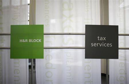 Signs at a H&R Block office are seen in Chicago