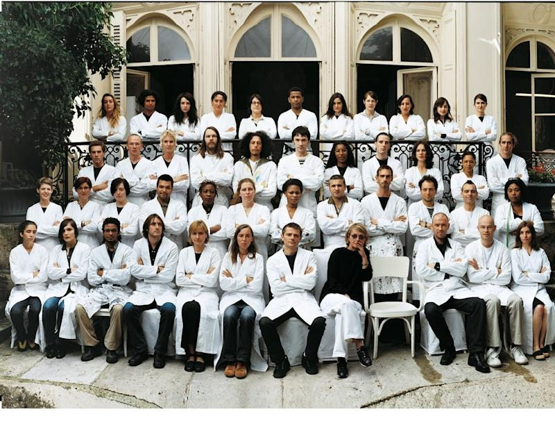 The Maison Martin Margiela team in 2008, with an empty seat for Martin Margiela