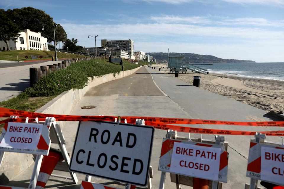 Barriers block the beach area in Redondo Beach, Calif., after Los Angeles County ordered parks, trails and beaches closed on March 28. (Patrick T. Fallon/Reuters)