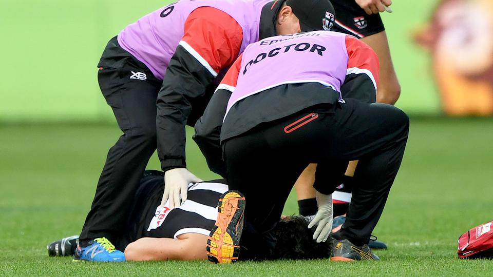 Pictured here, medical staff attend to Dylan Roberton after he collapsed in a 2018 AFL match.
