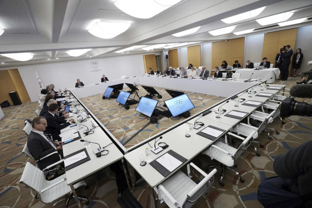 International Olympic Committee (IOC) President Thomas Bach, second from left in back, and other members attend an IOC Executive Board meeting in Tokyo Friday, Nov. 30, 2018. The focus of the meeting was a decision on what to do with boxings corruption-plagued international federation. (AP Photo/Eugene Hoshiko)