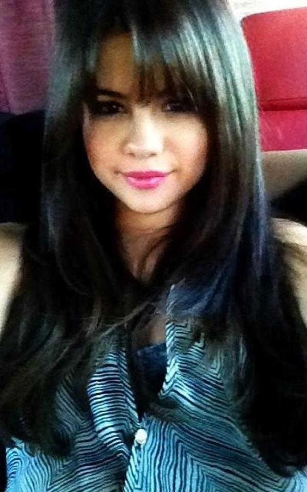 """Selena took to Facebook to give the world an up-close look at her new blunt bangs over the weekend. <span class=""""hasCaption"""">""""new hair for a new movie :) I love changing my hair!"""" she wrote.</span> Fans clearly approved. At last count, the post had more than 245,000 likes. The 20-year-old is currently shooting the thriller """"Getaway."""" (7/30/2012)"""