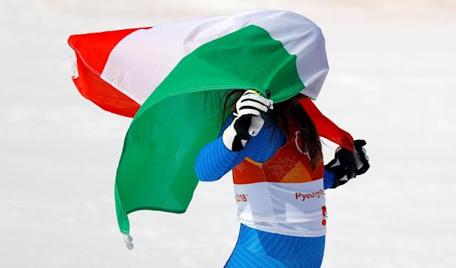 """Alpine Skiing - Pyeongchang 2018 Winter Olympics - Women's Downhill - Jeongseon Alpine Centre - Pyeongchang, South Korea - February 21, 2018 - Gold medallist Sofia Goggia of Italy celebrates with the Italian flag during the flower ceremony. REUTERS/Leonhard Foeger SEARCH """"OLYMPICS BEST"""" FOR ALL PICTURES. TPX IMAGES OF THE DAY."""