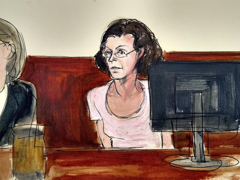 In this courtroom drawing, Clare Bronfman, is arraigned at federal court in New York, Tuesday, July 24, 2018. Bronfman, a daughter of the late billionaire philanthropist and former Seagram chairman Edgar Bronfman Sr., and three other people associated with the NXIVM organization were taken into custody and charged with racketeering conspiracy, the U.S. attorney's office in the Brooklyn borough of New York announced. (AP Photo/Elizabeth Williams)