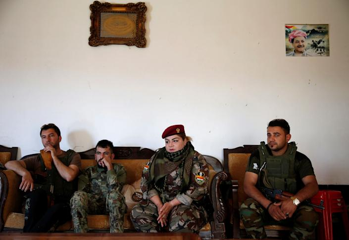Nauzad sits with other fighters in Nawaran.