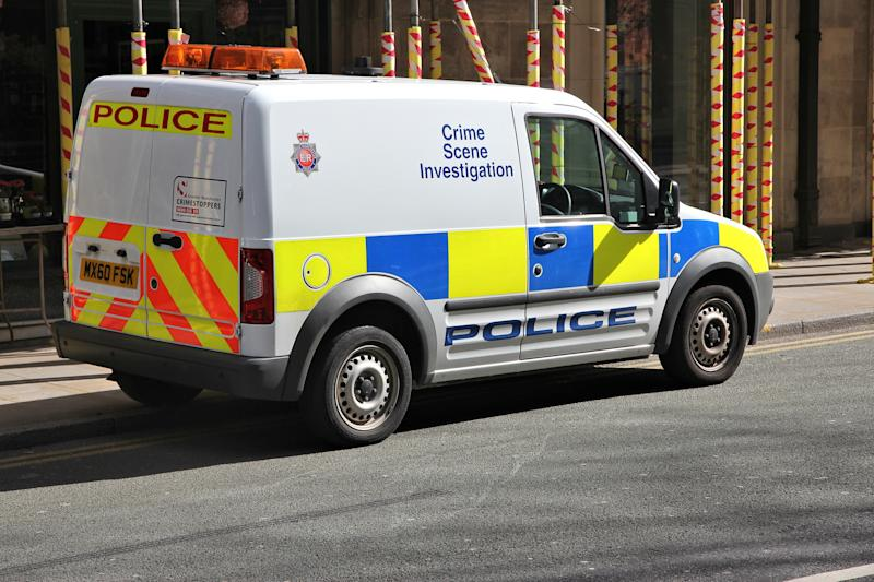 British Police Crime Scene Investigation vehicle parked in Manchester, UK. The car is Ford Tourneo.