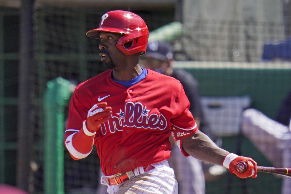 Philadelphia Phillies' Andrew McCutchen drives in a run with a single off New York Yankees starting pitcher Gerrit Cole during the third inning of a spring training exhibition baseball game in Clearwater, Fla., Thursday, March 11, 2021. (AP Photo/Gene J. Puskar)