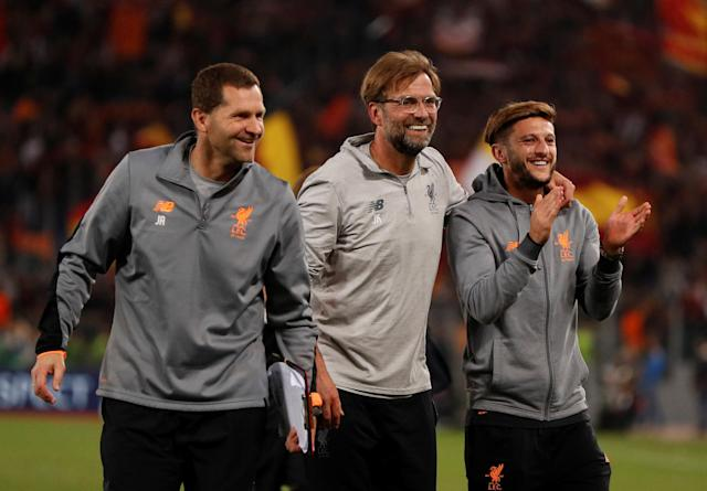 Soccer Football - Champions League Semi Final Second Leg - AS Roma v Liverpool - Stadio Olimpico, Rome, Italy - May 2, 2018 Liverpool manager Juergen Klopp celebrates with Adam Lallana and goalkeeping coach John Achterberg after the match Action Images via Reuters/John Sibley