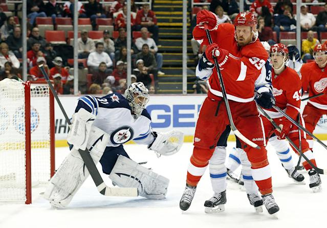 Detroit Red Wings left wing Johan Franzen (93), of Sweden, tries to redirect a shot against the Winnipeg Jets during the second period of an NHL hockey game in Detroit, Tuesday, Nov. 12, 2013. (AP Photo/Paul Sancya)