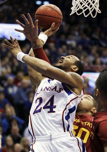 Kansas guard Travis Releford (24) shoots while covered by Iowa State forward Royce White (30) during the first half of an NCAA college basketball game in Lawrence, Kan., Saturday, Jan. 14, 2012. (AP Photo/Orlin Wagner)