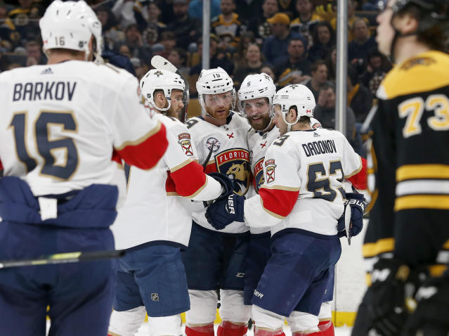 Florida Panthers right wing Evgenii Dadonov (63)is congratulated by teammates after scoring a goal during the first period of an NHL hockey game against the Boston Bruins, Saturday, March 30, 2019, in Boston. (AP Photo/Mary Schwalm)