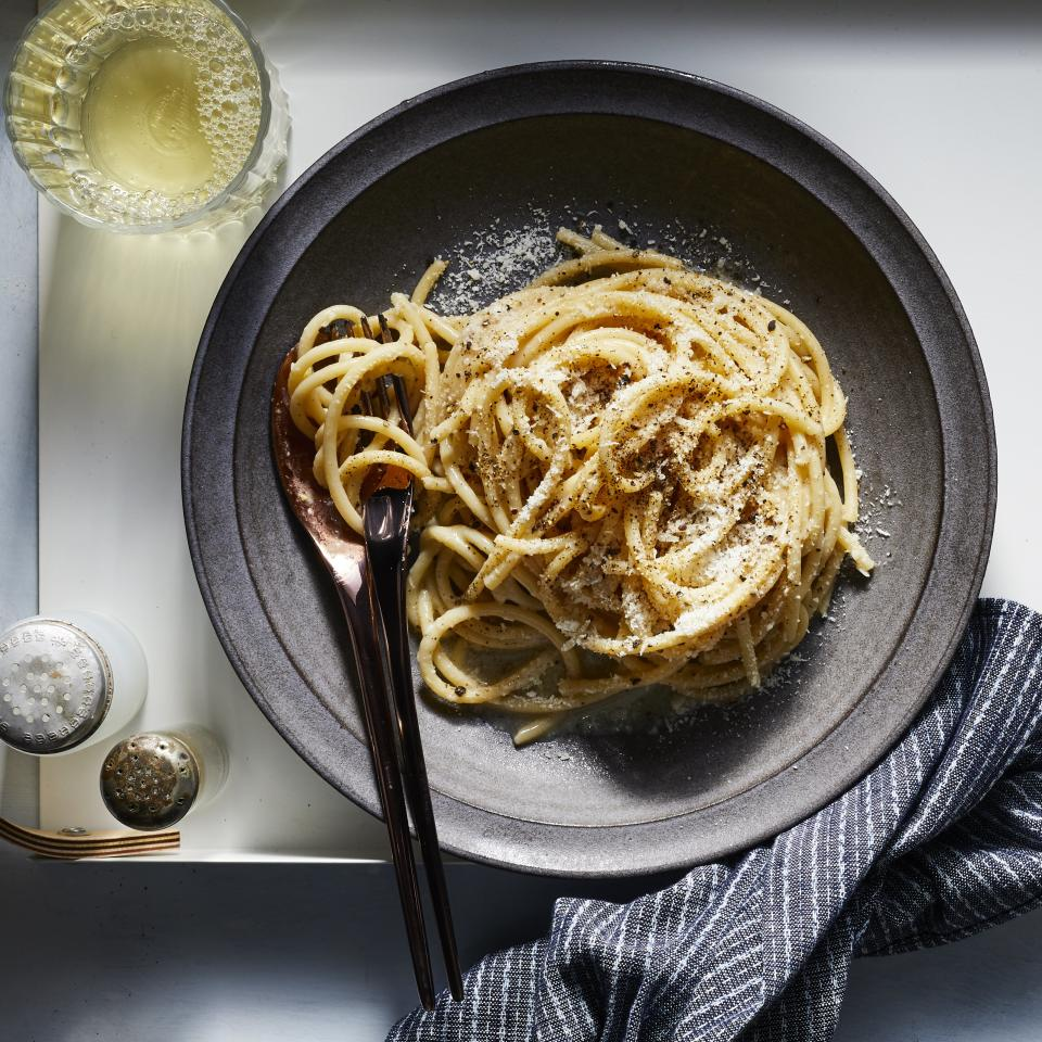 "<p>This foolproof method delivers the classic, crave worthy flavors and textures of cacio e pepe—strong peppery backbone (without verging towards too ""hot""), earthy saltiness from the <a href=""https://www.myrecipes.com/ingredients/whats-the-difference-between-parmesan-parmigiano-reggiano-pecorino-romano"">Pecorino</a> cheese, and a luscious sauciness that will have you ready to lick the bowl. That said, while our method largely stays true to the iconic dish, one element might catch a traditionalist's eye: olive oil. Though not exactly typical in cacio e pepe, we found that incorporating olive oil makes emulsifying the delicate cheese sauce a far less finicky process. Grating the cheese (as opposed to shredding) or using a <a href=""https://www.amazon.com/Microplane-40020-Classic-Zester-Grater/dp/B00004S7V8"">Microplane</a> is also key, as this allows the cheese to melt quickly. And finally, remember that pasta water is your best friend when it comes to making a silky smooth sauce. We developed this recipe for two as it makes for a incredibly impressive—yet budget-friendly—date night dinner when served with a simple green salad and a dry white wine. However, you can easily double the recipe to serve more. We love bucatini for this recipe because the hollow noodle is perfect for capturing the rich sauce, but you can use whatever <a href=""https://www.myrecipes.com/ingredients/underrated-pasta-shapes"">noodle shape</a> you like; linguine, spaghetti,or fettuccine are all great options. </p> <p><a href=""https://www.myrecipes.com/recipe/cacio-e-pepe"">Cacio e Pepe Recipe</a></p>"