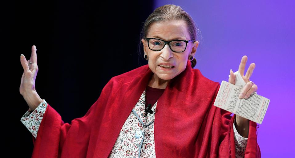 Ruth Ginsburg is seen holding her hands in the air while smiling. Source: AAP