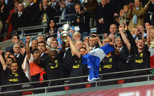 LONDON, ENGLAND - MAY 11: Emmerson Boyce (L) and Gary Caldwell (R) of Wigan Athletic lift the trophy following their team's 1-0 victory during the FA Cup with Budweiser Final between Manchester City and Wigan Athletic at Wembley Stadium on May 11, 2013 in London, England. (Photo by Shaun Botterill/Getty Images)