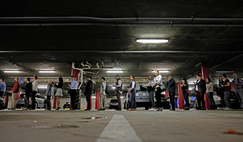 A line backs up into a parking garage outside a polling site on election day in Atlanta, Tuesday, Nov. 6, 2018. (AP Photo/David Goldman)