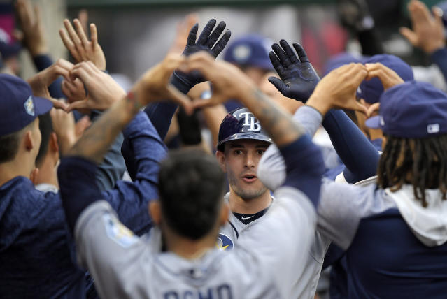 Tampa Bay Rays' Daniel Robertson celebrates with teammates after hitting a grand slam during the second inning of a baseball game against the Los Angeles Angels, Saturday, May 19, 2018, in Anaheim, Calif. (AP Photo/Mark J. Terrill)
