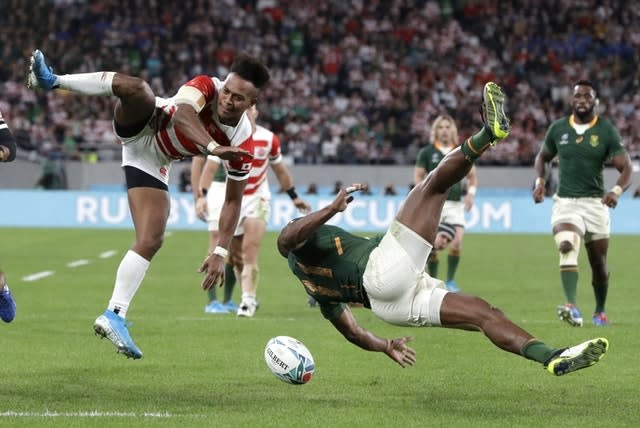 Makazole Mapimpi (bottom right) bagged a brace as South Africa beat Japan 26-3 to book a World Cup semi-final with Wales (Mark Baker/AP)
