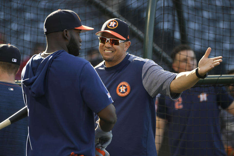 Astros hitting coach Alex Cintron, center, has been in the middle of three controversies. (Photo by John McCoy/Getty Images)