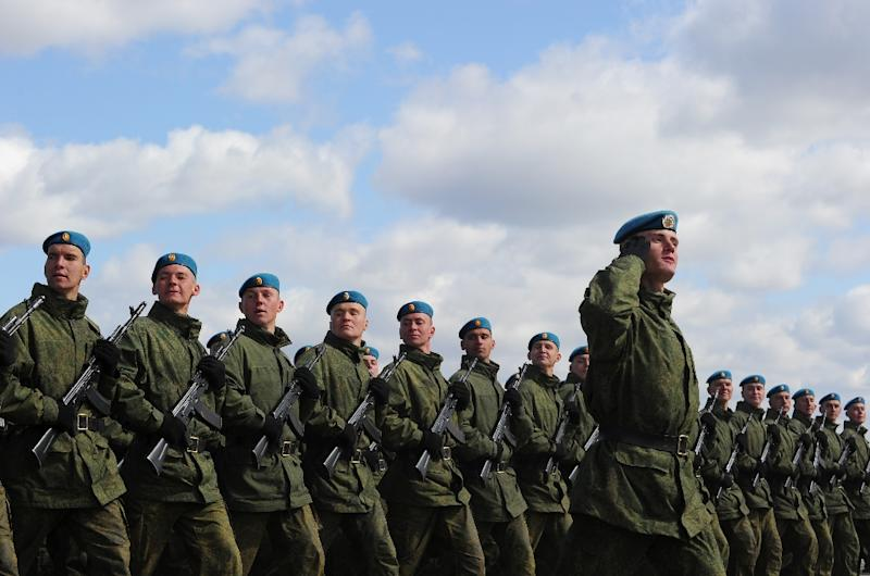 Russian paratroopers march outside Moscow on April 20, 2011