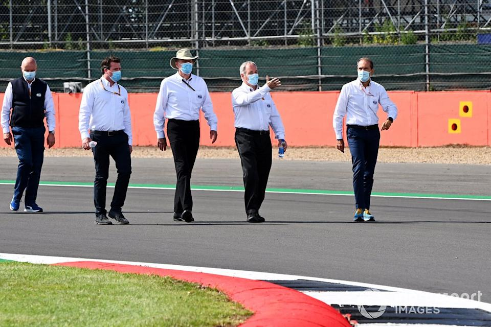 """FIA personnel walk the track<span class=""""copyright"""">Mark Sutton / Motorsport Images</span>"""