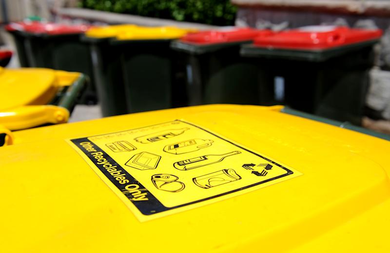 A yellow recycling bin as Noosa Council implements bin inspections. Source: AAP Image/Tracey Nearmy.