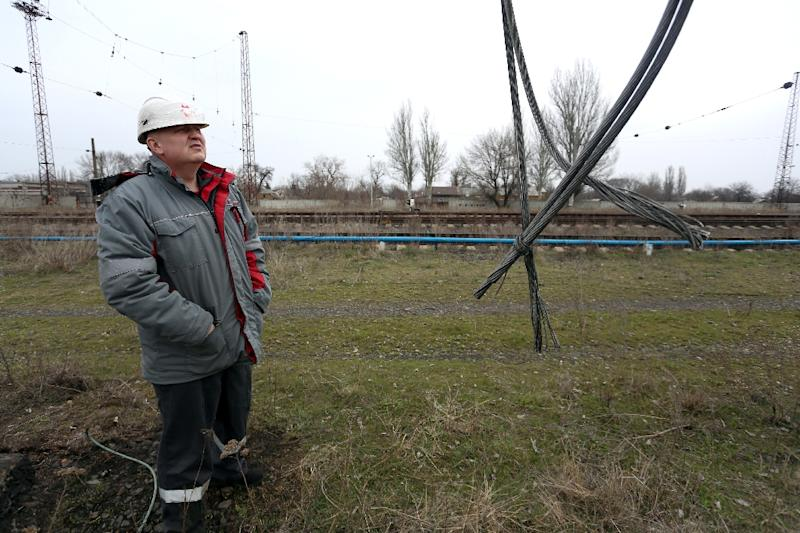 Ruslan Kolesov, Director of transport at the Avdiivka Coke and Chemical Plant, examines power lines damaged by shelling between Ukrainian forces and the Russian-backed rebels near Avdiivka, in March 2017 (AFP Photo/Aleksey FILIPPOV)