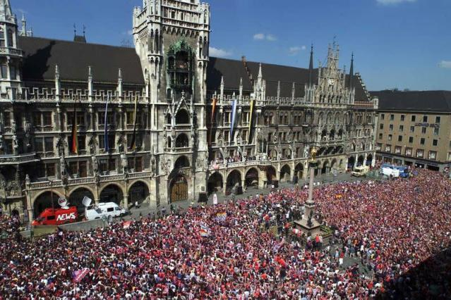 FILE PHOTO: Tens of thousands of enthusiastic Bayern fans congregate in downtown Munich on the famous Marienplatz to celebrate the club's double-winning season.