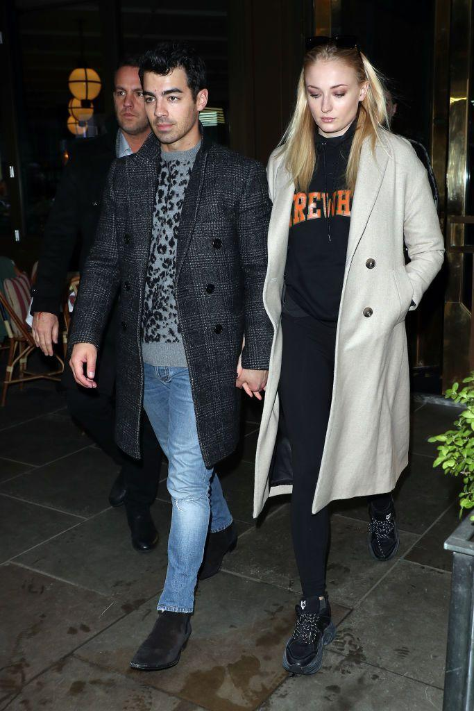 <p>Joe Jonas and Sophie Turner had a low-key lunch at the Ivy Soho before heading over to department store Selfridges in London. The Game Of Thrones star, 23, wore Balenciaga trainers and an ivory coat whilst 30 year-old Jonas wore a leopard-print jumper for the casual day out. </p>
