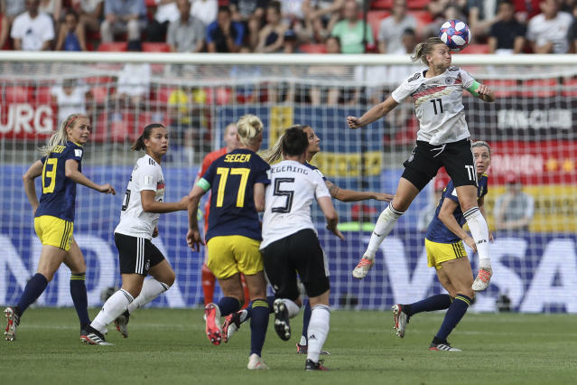 Alexandra Popp jumps for the ball during the 2019 FIFA Women's World Cup France Quarter Final match between Germany and Sweden at Roazhon Park on June 29, 2019 in Rennes, France. (Photo by Maja Hitij/Getty Images)