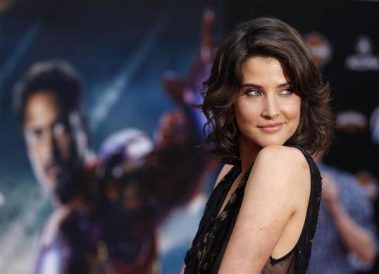 """Cobie Smulders poses at the world premiere of """"Marvel's The Avengers"""" in Hollywood, April 11, 2012."""