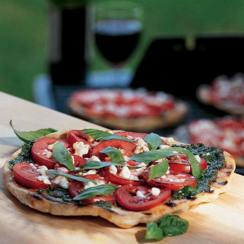 <p>Dazzle your guests, and keep the kitchen cool, by baking pizza on the backyard grill. For convenience, this recipe uses prepared pizza dough, found in most supermarkets, and pesto from a jar.</p>