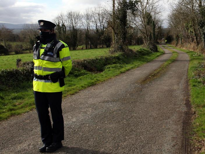<p>Garda at the scene near Curraghgorm, County Cork, following the deaths of three brothers.</p> (PA)