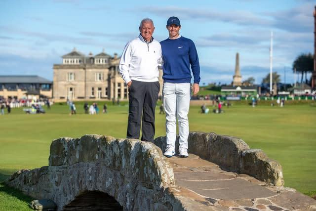 Rory McIlroy poses with his father Gerry on the Swilken bridge during day three of the Alfred Dunhill Links Championship at St Andrews (Kenny Smith/PA)