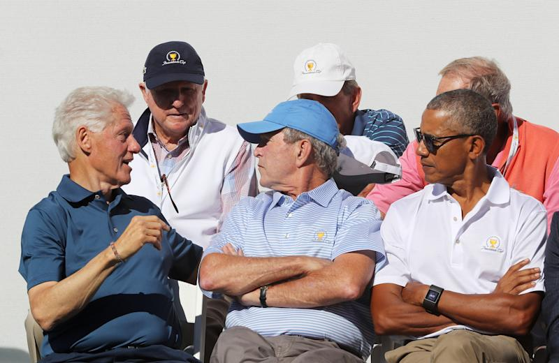 As Clinton chats, Bush and Obama are among those listening. (Sam Greenwood via Getty Images)