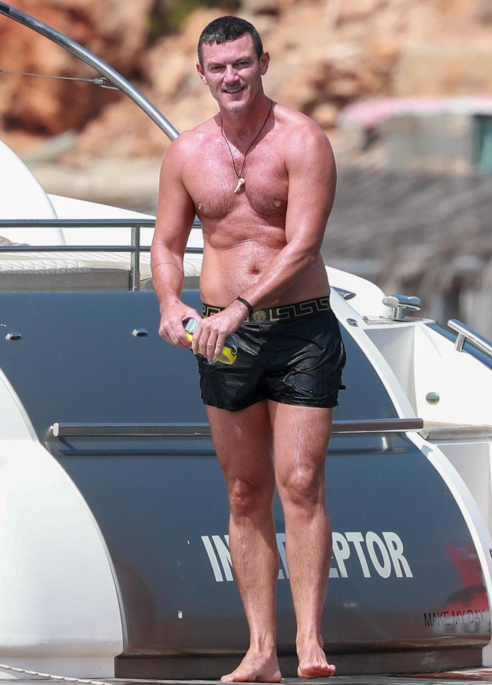 <p>Luke Evans shows off his enviable physique on Thursday while vacationing in Ibiza. </p>
