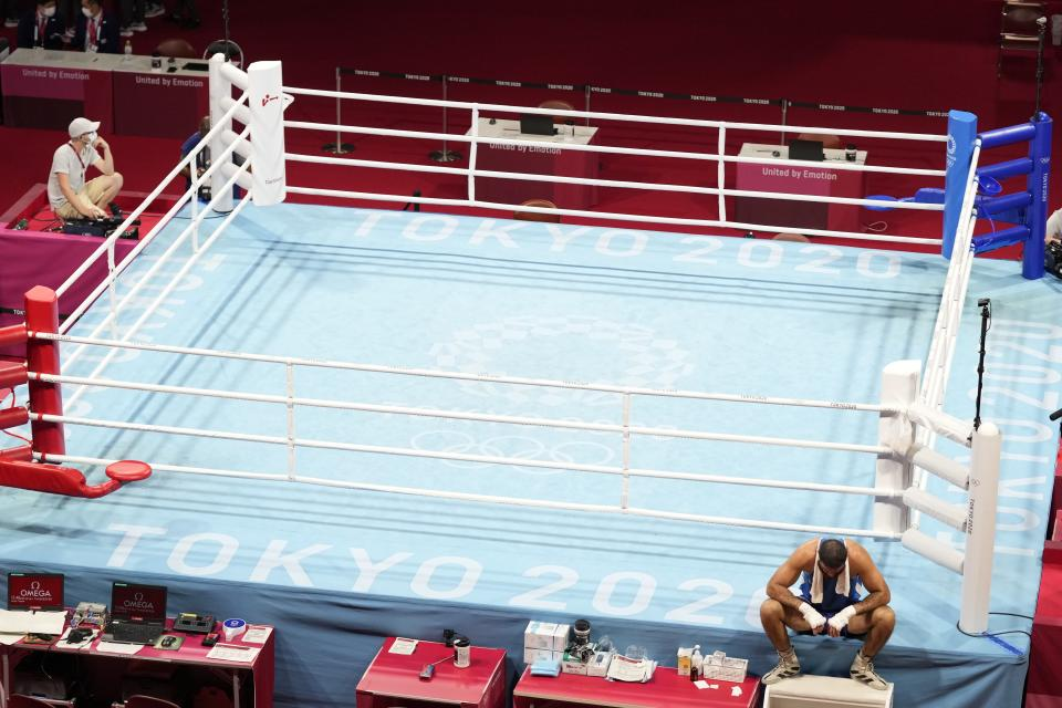 Eliad Mourad, of France refuses to leave the ring after losing a men's super heavyweight over 91-kg boxing match against Britain's Frazer Clarke at the 2020 Summer Olympics, Sunday, Aug. 1, 2021, in Tokyo, Japan. (AP Photo/Frank Franklin II)