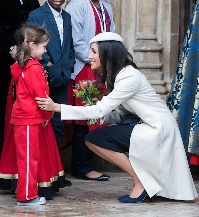 The soon-to-be duchess crouched down to meet a young fan. (Samir Hussein via Getty Images)