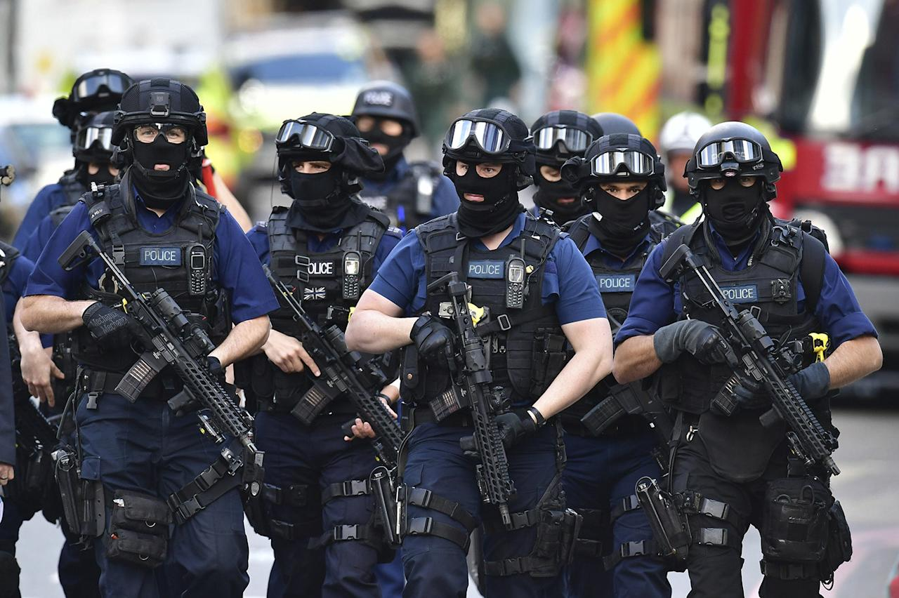 <p>Armed police patrol St. Thomas Street in London, Sunday, June 4, 2017. Police specialists collected evidence in the heart of London after a series of attacks described as terrorism killed several people and injured more than 40 others. (Photo: Dominic Lipinski/PA via AP) </p>