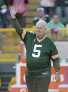 "FILE - In this Oct. 2, 2011 file photo, former Green Bay Packer Paul Hornung waves to the crowd during an NFL football game in Green Bay, Wis. Hornung, the dazzling ""Golden Boy"" of the Green Bay Packers whose singular ability to generate points as a runner, receiver, quarterback, and kicker helped turn them into an NFL dynasty, has died, Friday, Nov. 13, 2020. He was 84. (AP Photo/Mike Roemer, File)"