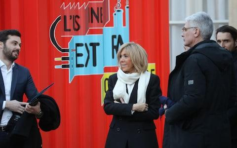 Brigitte Macron (C), wife of French President Emmanuel Macron, and her advisors look at products made in France displayed in the courtyard of the Elysee in Paris - Credit: AFP