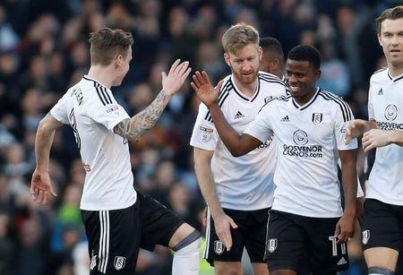 Soccer Football - Championship - Fulham vs Aston Villa - Craven Cottage, London, Britain - February 17, 2018 Fulham's Floyd Ayite celebrates with team mates after scoring their second goal Action Images/Paul Childs