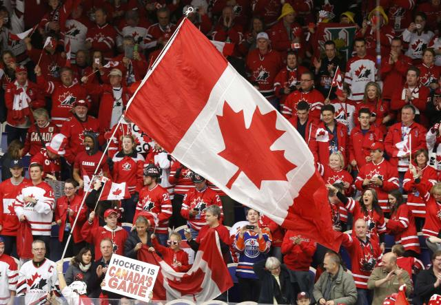 Canadian supporters cheer after Canada defeated the United States in their IIHF World Junior Championship ice hockey game in Malmo, Sweden, December 31, 2013. REUTERS/Alexander Demianchuk (SWEDEN - Tags: SPORT ICE HOCKEY)