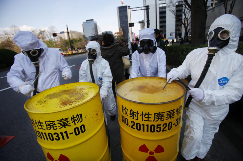 """Costumed protesters beat drum cans during an anti-nuclear plant demonstration in Tokyo, Sunday, March 9, 2014. Banging on drums and waving """"Sayonara nukes"""" signs, thousands of people rallied in a Tokyo park and marched to Parliament to demand an end to nuclear power ahead of the third anniversary of the Fukushima disaster. The demonstration Sunday is one of many such protests that have erupted since the March 11, 2011, nuclear disaster, the worst since Chernobyl. (AP Photo/Junji Kurokawa)"""